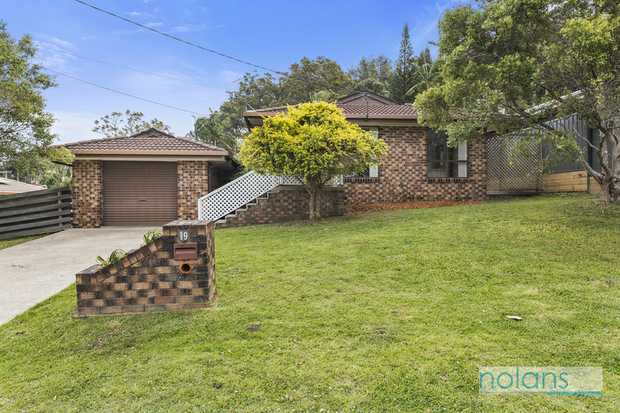 This neat brick and tile home offers the ultimate in convenience.  Within minutes of the town centre...
