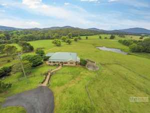 Riverfront retreat on 17 lush acres...