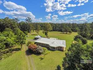A generous country home on 40 parklike acres...
