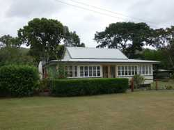 This lovingly renovated period cottage is situated on an almost flat 1 acre block in the centre of K...