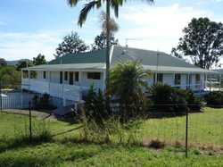 This large highset Queenslander is situated on a lovely gently sloping 1.5 acres with elevated views...