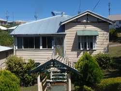 Situated right in the heart of Gympie is a neat and tidy timber miners cottage on a large block with...
