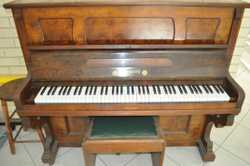 "Antique upright piano ""H Lubitz"" Berlin.  Was tuned approximately 3 years ago.  Comes with bench sea..."