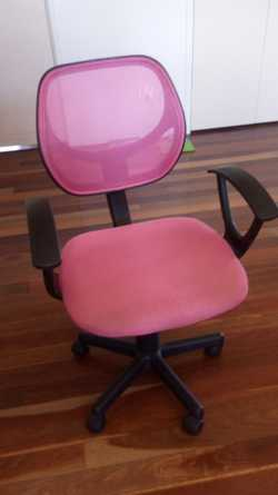 Chair pink in colour cushioned seat  with mesh back rest height adjustable to 95 cm.,  width 51 cm