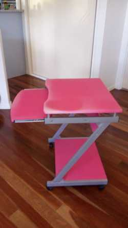 Desk is pink in colour  height 75 cm,  width 62 cm and debth with  table drawer on  metal runners 71...