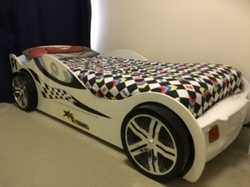 White turbo racing car bed with draw and mattress.