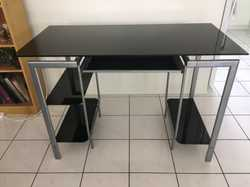 Desk Information:  • Desk is made from black tempered glass (4x stronger than regular glass).  • Has...