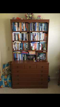 Wooden book shelf on top. Chest of 3 drawers below.