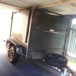 Features enclosed sealed cargo area with 3way access fitted with shock absorbers and mechanical brak...
