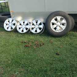 4 16in wheel rims 1 slight mark on it tyre worn