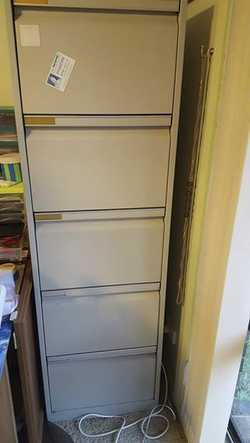 5 drawer filing cabinet, grey, used, good condition, no key, advertised elsewhere. Large quantity of...