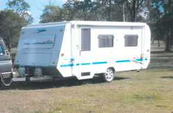 2001 Millard pop top 17ft, a/c, single beds, 3 way fridge, microwave, TV, plus more extras. New t...