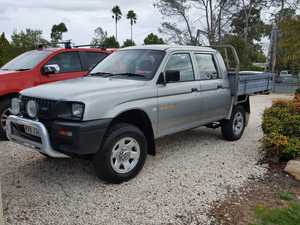 2003 Triton twin cab, 6 mths rego, petrol, manual, CD player, a/c, good condition, towbar, driving lights, bullbar, steel tray, $8750.00 ONO.