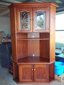 Solid Timber Cnr TV Unit, Lead Light Doors, 2010H, 1260W, VGC. $80. Ph: 0407128809