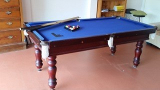Used 7 foot x 3.6 foot pool table with solid carved wooden legs, with  blue felt that has been patch...