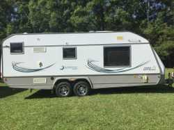 Tandem axle 21ft, light weight van. It has a roll out awning, full ensuite, queen size island bed an...