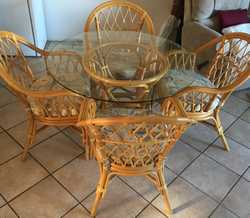 5 piece glass top cane dining table for sale in excellent condition.