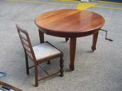 Oval Walnut Table with two extensions and winder. six chairs.  100 years young.