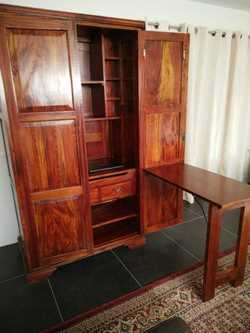 Convertible desk/workstation that folds away into a solid mahogany cupboard. Space for computer, har...