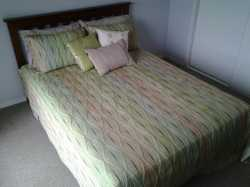 Timber frame 2 yrs old guest room  rarely used . Bed linen opt $20