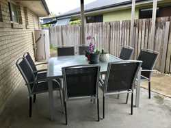 Glass table, metal trim. Sling back chairs. Selling ASAP.