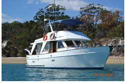 GO ANYWHERE. Comfortable diesel cruiser, twin Ford 6cyl 5.7KW generator, gas stove, freezer, frid...