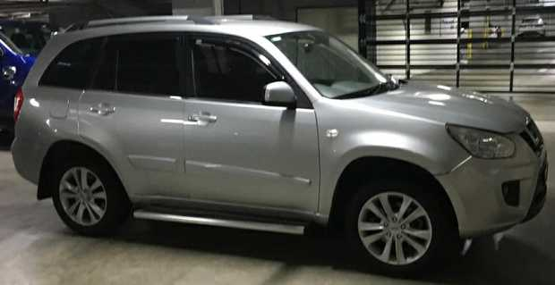 Station wagon, manual, silver, air cond., side steps, tinted windows.