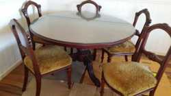 Mahogany round table , five chairs , glass protective  cover.