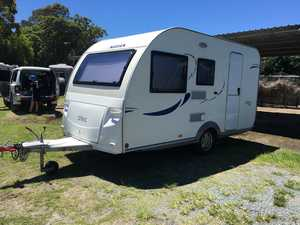 Lovely compact caravan no need for 4wheel drive to tow 16 ft sleeps four with two seating areas one of which makes into bunkbed and the other makes a double , as full size fridge and oven with three gas rings , all window have fly screens and blinds , Wash basin shower ...