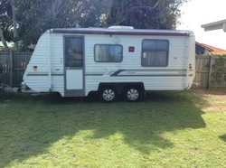 18ft 6 inches, Dual axle, new tyres. Island double bed, 12/240v lighting, 4 burner gas stove, microw...