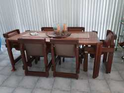 Genuine 1983 suite.  Table 900x1900 plus six leather chairs.   Well maintained