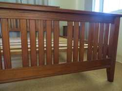 Solid timber Queen slat bed and two bedside tables. Bed: H 130cm x W 165cm x D 219cm. Bedsides: H 72...