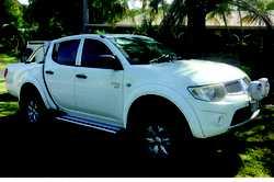 2012 MITSUBISHI Triton Dual Cab White, manual, VGC Tow Bar & Bull Bar, etc. $21,500 Phone 042...