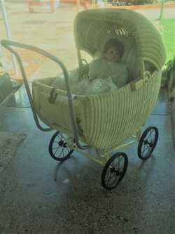 60 yr cane pram with doll.  Very good cond. ph 0409 860 637