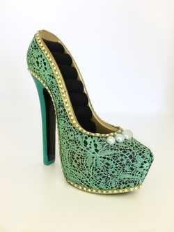stiletto heel design, green lace, holds 8 rings, comes in original box, never used.