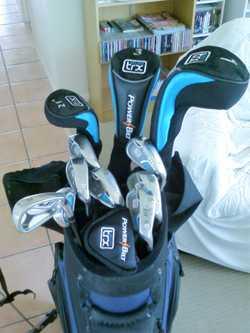 Full set titanium golf clubs, buggy, golf bag with travel hood, 2 bags golf balls. I am asking a mer...