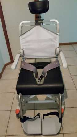 Invacare Hoist with sling never been used. Etac delux shower chair with adjustable head rest support...