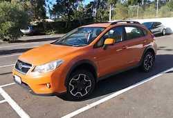 SUBARU XV 2012 One Owner, only 28K, 2.0i auto, AWD, SUV, 5 door, orange. $18,000. Phone 045811033...