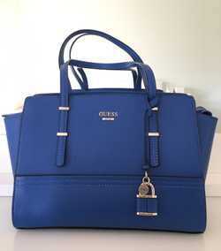 Brand New, never used, Royal Blue, med size, comes with dust bag, RRP: $200, sell $150.