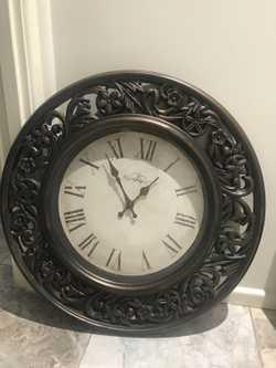 Bronze/ brown flower scroll clock. 50cm rnd.