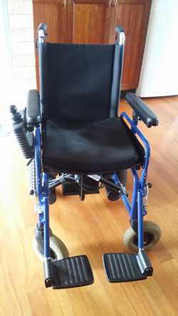 Electric Wheel Chair with charger and working rechargeable battery. GC
