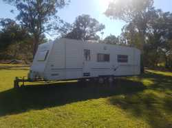 Good condition, 2 front bunks, island bed, shower, vanity, hot water, 2 door fridge, 4 burner sto...