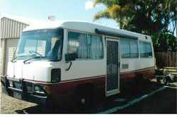 TOYOTA Coaster 92 Model 6 months rego, with 12-24 fridge, stove, sink, toilet, beds, awning. Driv...