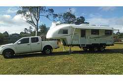 TRAVELHOME    as new,  set-up for free camping,  solar has many extras  $59...