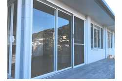 STACKER SLIDING DOOR brand new, similar to photo, no flyscreen 2150x2100, $800, Buderim 041135422...
