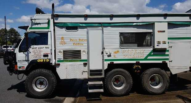 Mitsubishi truck with custom cabin.