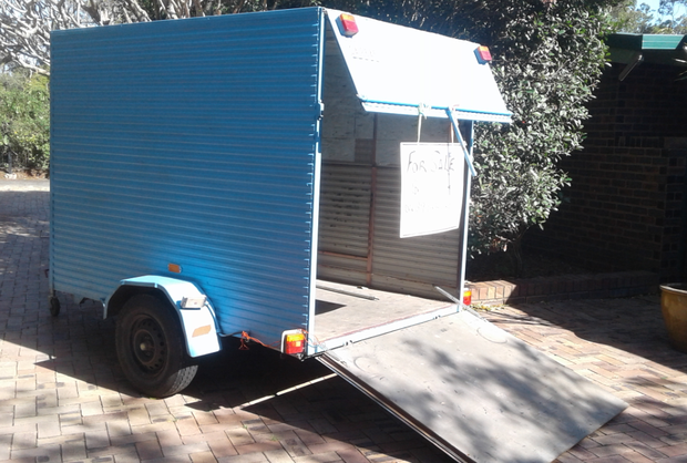 Approx 8x5, can carry furniture.