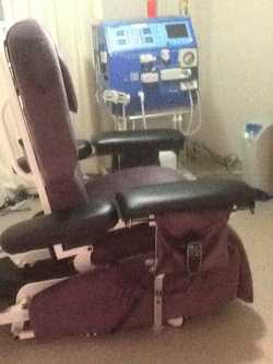 Adustable back and leg support to several positions. Has two electric motors and upholstered in wate...