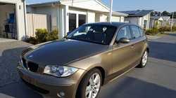 BMW 12Oi 2006.    Sonora Gold Metallic with beige leather trim,  VGC  145,500km,...