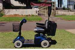 Pride Electric Scooter With hood & rear bag, registered, in good condition, $1200 ono.